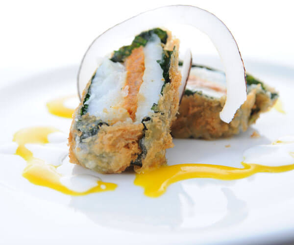 Crispy cod fillet stuffed with spicy coconut prawn paste & passion fruit coconut dressing